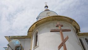 The top of the church. Against the sky and cloud stock footage