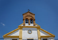 Top of a church in a town of Granada, on a sunny day Royalty Free Stock Photography