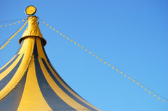 Top of a circus tent. The top of a coloured circus tent on a blue sky Royalty Free Stock Photo