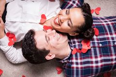 Top close up view on couple lying on the floor Royalty Free Stock Images