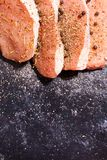 Top close up view on uncooked meat seasoned with spices, pepper Stock Image