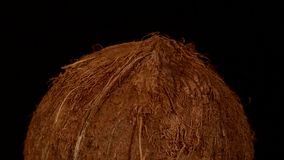 Top of coconut isolated on black, rotation stock video footage