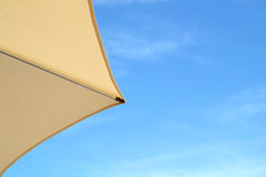 Top of a Colorful Beach Umbrella against the Sky. stock photo