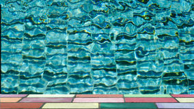 Top of colorful brick in front of water ripple pattern in pool Royalty Free Stock Photo