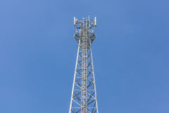 Top of communications tower with blue sky background. Stock Photo