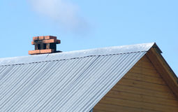 Top of country wooden house with metal roof an Royalty Free Stock Images