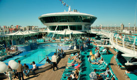 Top of Cruise Ship. Many people taking advantage of the sunbathing opportunities stock images