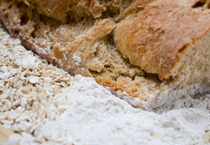 Top crust of rye bread. Rump grain bread close-up with flour and cereal stock photography