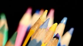 Top of different colour pencils isolated on black stock video