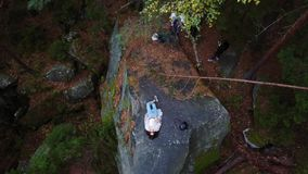 Top down aerial drone image of a forest. Top down aerial drone image of a forest, woman lies on a rock stock footage