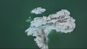 Top down aerial view of glacier icebergs floating in lagoon in Iceland stock footage
