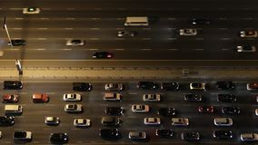 Top down aerial view of heavy traffic on freeway at night. stock footage