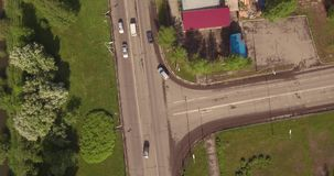 Top down aerial view of small crossroad in provincial town. Top down aerial view of small intersection in provincial town stock video