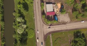 Top down aerial view of small crossroad in provincial town. Top down aerial view of small intersection in provincial town stock footage
