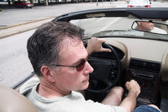Top Down Driving. Man in a convertible driving with the top down Royalty Free Stock Images