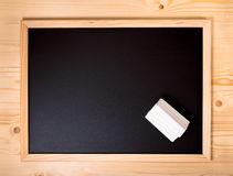 Top down empty blank school black board with white chalks on woo Royalty Free Stock Photo