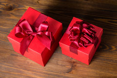 Top down of festive red box with bow on wooden background is iso. Top down of festive red box with bow on wooden background is , closeup Royalty Free Stock Photo