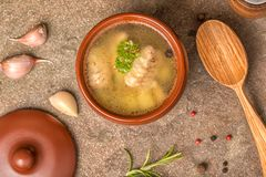 Top down of fish soup with sturgeon, potatoes in clay plate, dec royalty free stock photography
