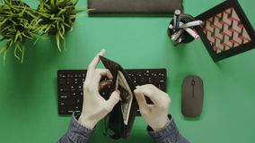 Top down shot of man counting cash money from wallet stock video footage
