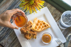 Top Down Shot of Pouring Syrup on Chicken and Waffles Royalty Free Stock Images