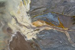 Top down view on abstract patterns and shapes of mineral waste rivers from power plant.  royalty free stock photography