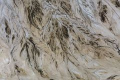 Top down view on abstract patterns and shapes of mineral waste rivers from power plant.  stock images