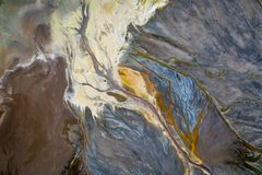 Top down view on abstract patterns and shapes of mineral waste rivers from power plant.  stock photos