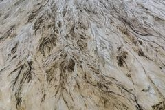 Top down view on abstract patterns and shapes of mineral waste rivers from power plant.  royalty free stock image