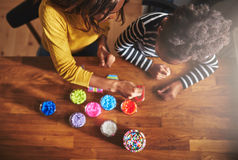 Top down view of adult and child choosing beads stock photo