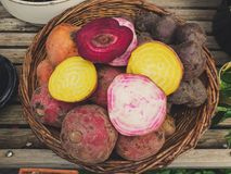 Top down view on a basket of root vegetables stock image