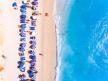 Top down view of a beach with tourists suntbeds and umbrellas wi Royalty Free Stock Photo