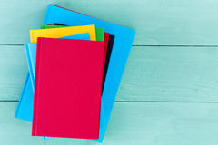 Top down view of blank books on blue table Stock Photo