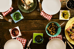 Top down view on empty plates and cups with food stock images