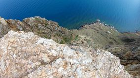Top down view of high cliff. Rocky coast stock footage