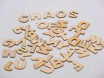 Top down view on wooden letters with the word chaos royalty free stock images