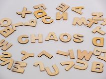 Top down view on wooden letters with the word chaos stock photo