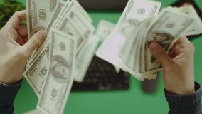Top down shot of man throwing his cash money down on table stock footage