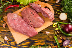 Top down view of meat on cutting board Stock Photos