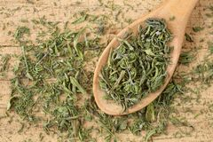 Free Top Down View Of Dried Summer Savory In A Wooden Spoon, On A Rustic Wooden Table. Close Up Of Chopped, Dry Satureja Hortensis, A Stock Image - 187644571