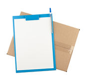 Top down view of open  cardboard box with clipboard on it Stock Photos