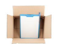 Top down view of open  cardboard box with clipboard in it Stock Photography