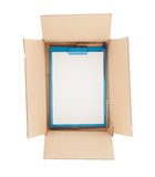 Top down view of open  cardboard box with clipboard in it Stock Images