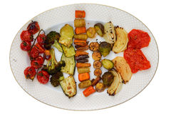 Top down view of oval plate with grilled veggies. Top down view of oval plate with grilled or roasted cherry tomatoes, broccoli, squash, carrots and other Stock Images