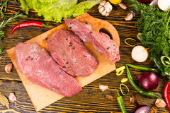 Top down view of raw meat on table Stock Photo