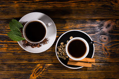 Top down view of tea and coffee over dark wood Stock Images