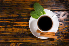 Top down view on tea with leaves and cinnamon Royalty Free Stock Photos