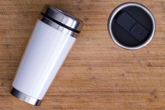 Top down view on thermos over wood surface Stock Photo