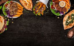 Top down view on traditional turkish meals on black stone table. royalty free stock photography