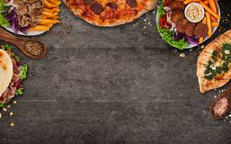 Top down view on traditional turkish meals on black stone table. stock photo