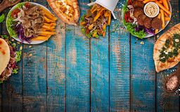 Top down view on traditional turkish meals on vintage wooden table. Stock Image